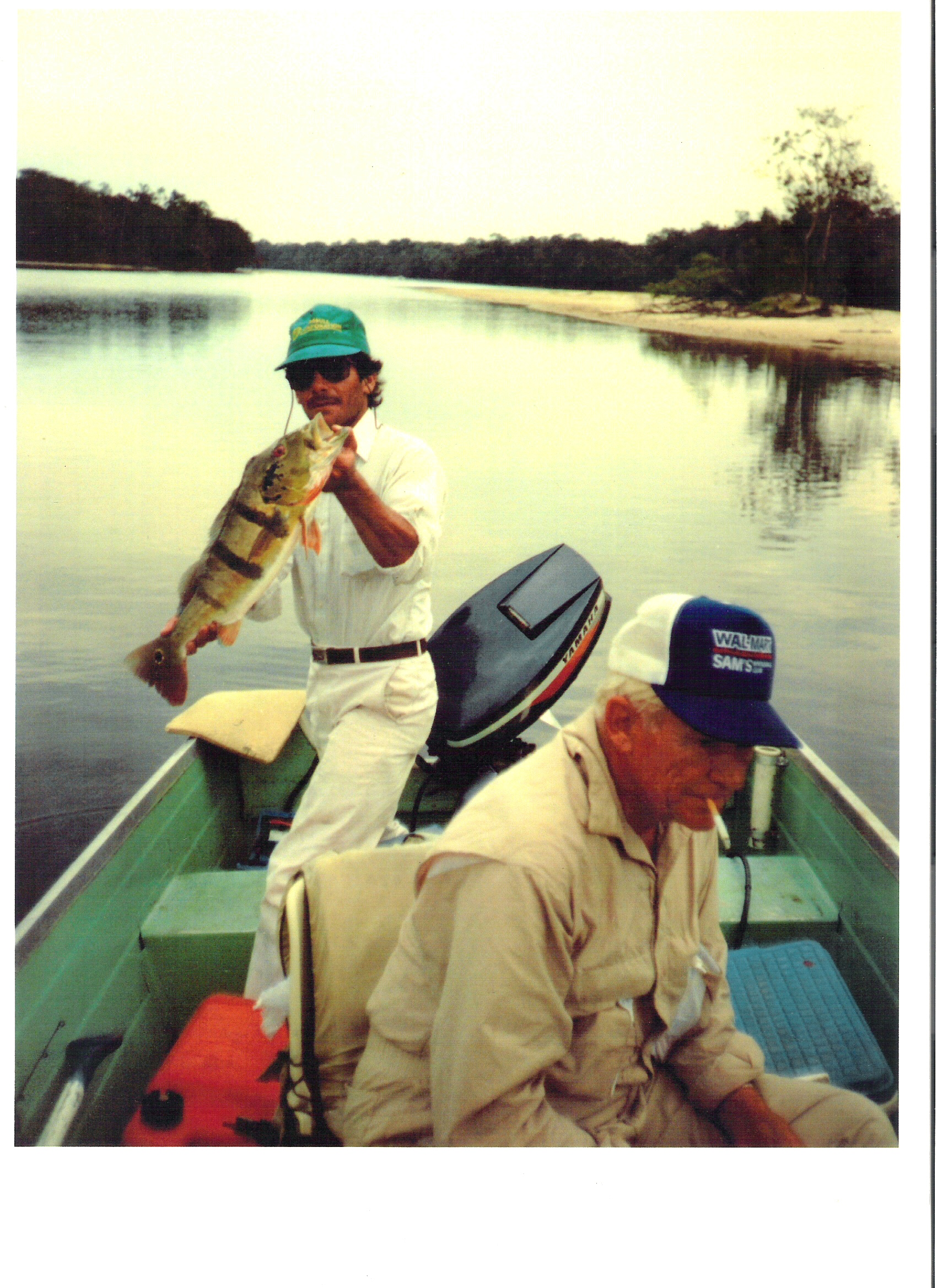 Bud Walton with his peacock bass in the Amazon